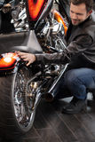 Customer examining motorcycle. Top view of cheerful young men in Stock Images