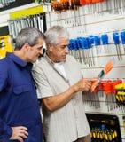 Customer Examining Packed Screwdriver While Vendor Stock Photo