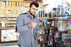 Customer examining various DIY details Stock Image