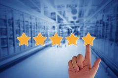 Customer Experience Concept. Service rating on blue background, hand and yellow star royalty free stock photo