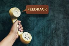 Customer Experience Concept, Hand raising Telephone and Listen F. Eedback from Client, Vintage Retro color tone Royalty Free Stock Photography
