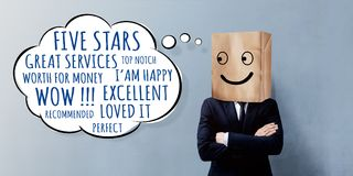 Customer Experience Concept. Happy Businessman Client with Smile. Y Emotion Face on Paper Bag, Crossed arms and looking at Wording of Positive Reviews on Think stock photos