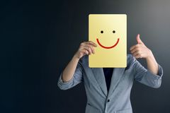 Customer Experience Concept, Portrait of Client Woman with Thumb. Up in meaning `Great` , Happy Smiley Face Drawn Emotion on Paper stock photography
