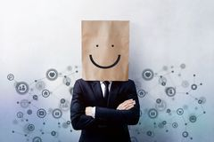Customer Experience Concept, Portrait of Happy Businessman Client with Smiley Face Emotion on Paper Bag, Crossed arms and wearing. Suit, Standing at the Wall royalty free stock photography