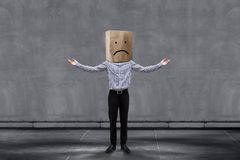 Customer Experience Concept, Unhappy Businessman Client with Sad. Ness Emotion Face on Paper Bag, Arms up with meaning of Disappointed and Wondering. Concrete royalty free stock images