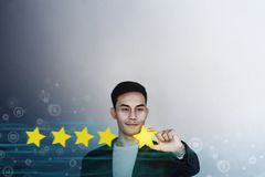 Customer Experience Concept. Young Businessman with Happy Face Showing his Five Star Services Rating Satisfaction. Happy Client`s