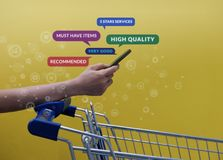 Customer Experience and Shopping LifestyleConcept. Smart Client. With Empty Cart Reading Online Positive Review via Smartphone before Buying Products stock photography