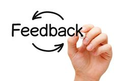 Customer Feedback Arrows Cycle Concept. Hand writing Feedback cycle arrows concept with black marker on transparent wipe board isolated on white royalty free stock photo