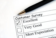 Customer feedback survey. Customer fills in the feedback survey Stock Photo