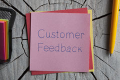 Customer Feedback written on a note Royalty Free Stock Photography