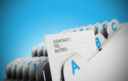 Customer File Concept. Folder tab organized alphabetically with focus on a contact note, blue background. Conceptual business image for illustration of customer Stock Image