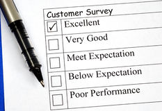 Customer fills in the feedback survey Stock Photo