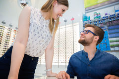 Customer flirting with shop assistant Royalty Free Stock Photos