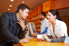 Customer with flu in pharmacy. Talking to a pharmacist Royalty Free Stock Photo
