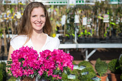 Customer at garden center posing with flowers Stock Photography