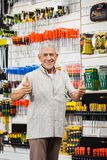 Customer Gesturing Thumbs Up In Hardware Shop Stock Photos