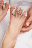 Customer getting a foot massage Royalty Free Stock Photography