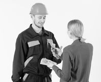 Customer give money to repairman, builder, mechanic with toolbox. Repairer happy get salary for work. Payday and payment. Concept. Woman client pay to men in royalty free stock photography