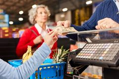 Free Customer Gives Cashier Cashier As Payment Stock Photo - 158856240