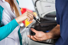 Customer Giving Car Keys To Mechanic Royalty Free Stock Image