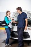 Customer Giving Car Keys To Technician At Garage Royalty Free Stock Image