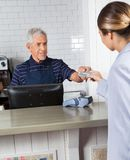 Customer Giving Credit Card To Cashier At Store Royalty Free Stock Images