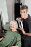 Customer With Hairdresser Holding Mirror Stock Photo