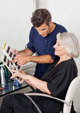 Customer And Hairstylist Selecting Hair Color Stock Image