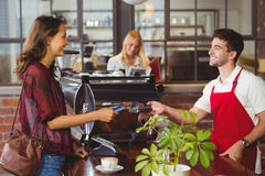 Customer handing a credit card to the waiter. At the coffee shop Stock Photography
