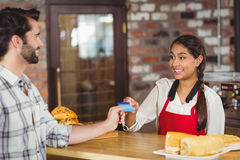 Customer handing a credit card to the waitress. At the coffee shop Stock Photo
