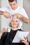 Customer Having Haircut At Parlor Stock Photos