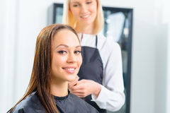 Customer and her stylist in the salon royalty free stock images