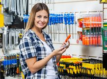 Customer Holding Cellphone And Screwdriver In Stock Image
