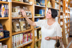 Customer holding with cereal products Stock Images