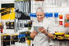 Customer Holding Digital Tablet In Hardware Shop Stock Image