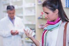 Customer holding a drug box Stock Image