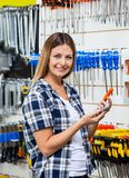 Customer Holding Mobilephone And Screwdriver In Stock Photo