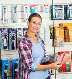 Customer Holding Packed Product In Hardware Store Royalty Free Stock Photos