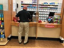 Customer inside a pharmacy shop. Customer inside a pharmacy shop pick up his prescription at a local Walgreens in Gilbert Arizona stock images