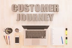 Customer Journey. Text concept with notebook computer, smartphone, notebook and pens on wooden desktop. 3D render illustration Stock Photography