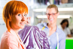 Customer in laundry shop or textile dry-cleaning Royalty Free Stock Photography