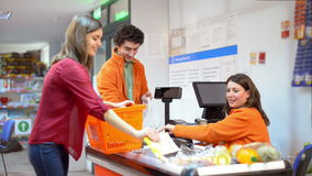 Customer in line at checkout Stock Footage