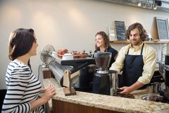 Customer Looking At Baristas Making Coffee In Stock Photography