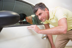 Customer looking at the car body Royalty Free Stock Image