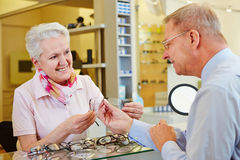 Customer looking for glasses at Royalty Free Stock Photo
