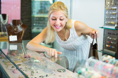 Customer looking jewellery gifts  in glass showcase Stock Images