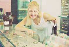 Customer looking jewellery gifts  in glass showcase Stock Photography