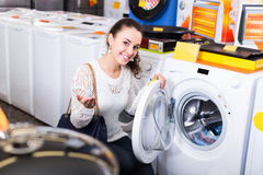 Customer looking at washers Royalty Free Stock Images