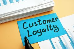 Customer loyalty concept. Pile of marketing documents. And marker royalty free stock images