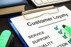 Customer Loyalty program and pen. Service Satisfaction. Customer Loyalty program quiz and pen. Service Satisfaction royalty free stock photography